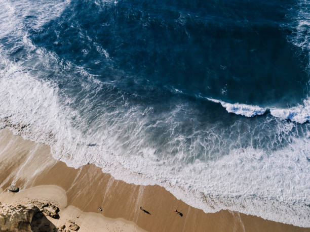 High Angle View Of Water and Rocks Droneshot, High Angle View Of Water and Rocks, Portugal eroded stock pictures, royalty-free photos & images