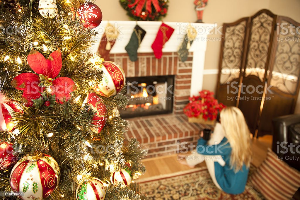 High angle view of woman on floor by Christmas tree royalty-free stock photo