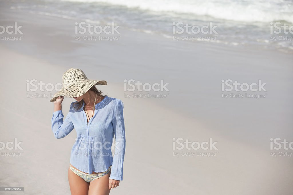 High angle view of woman wearing hat on beach royalty-free stock photo