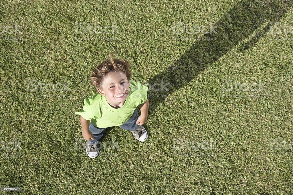 High angle view of young boy looking at camera stock photo