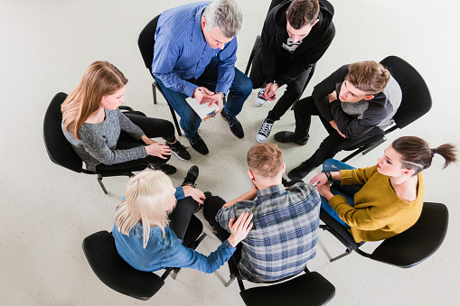 High Angle View Of Young Students And Therapist Stock Photo - Download Image Now