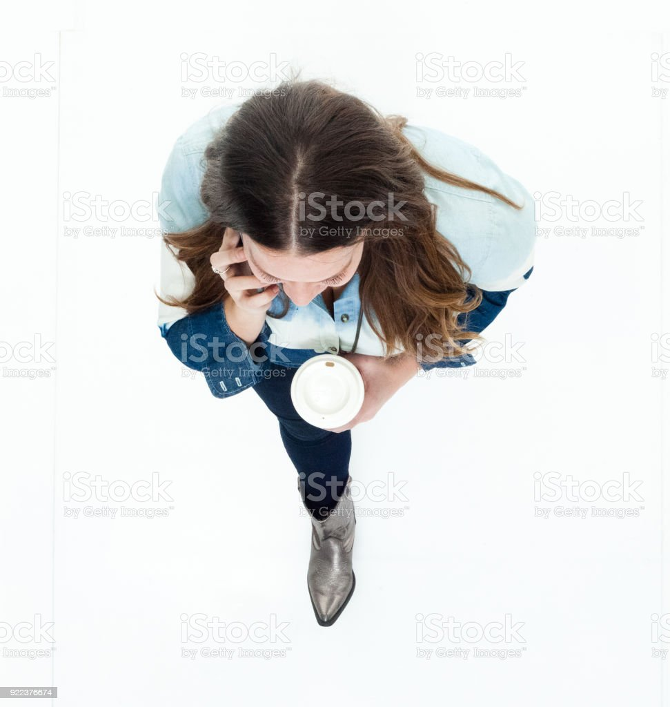 High angle view of young woman on the phone stock photo