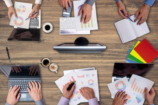 High angle view on business people working together stock photo