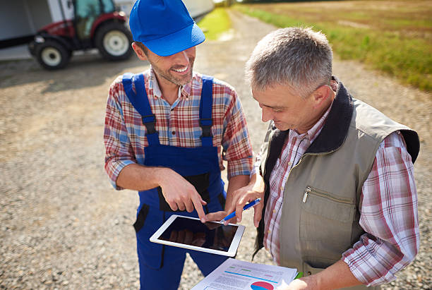 High angle view on modern farmers with digital tablet - foto de stock