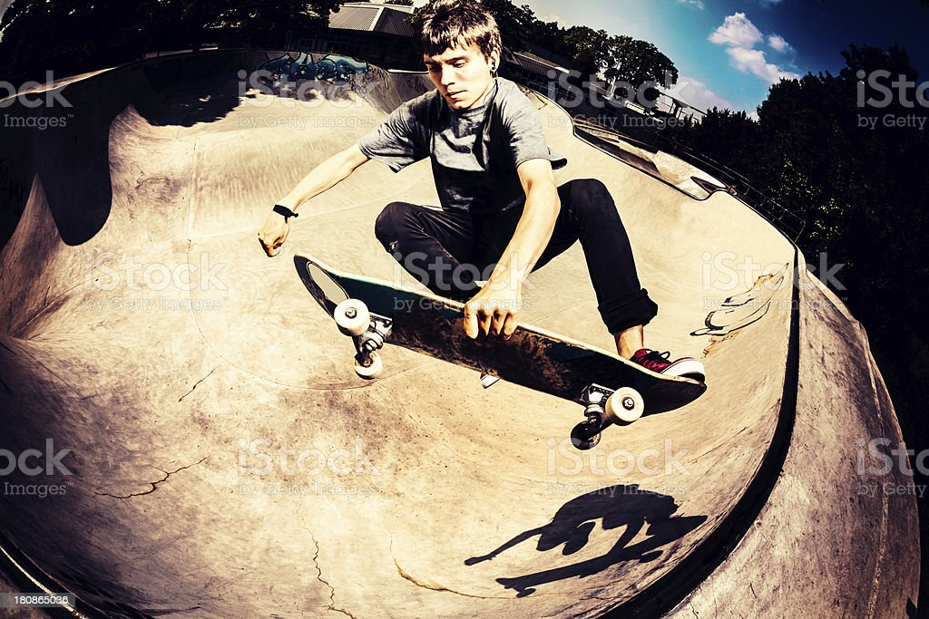 High Angle view on skateboarder jumping in skatepark stock photo