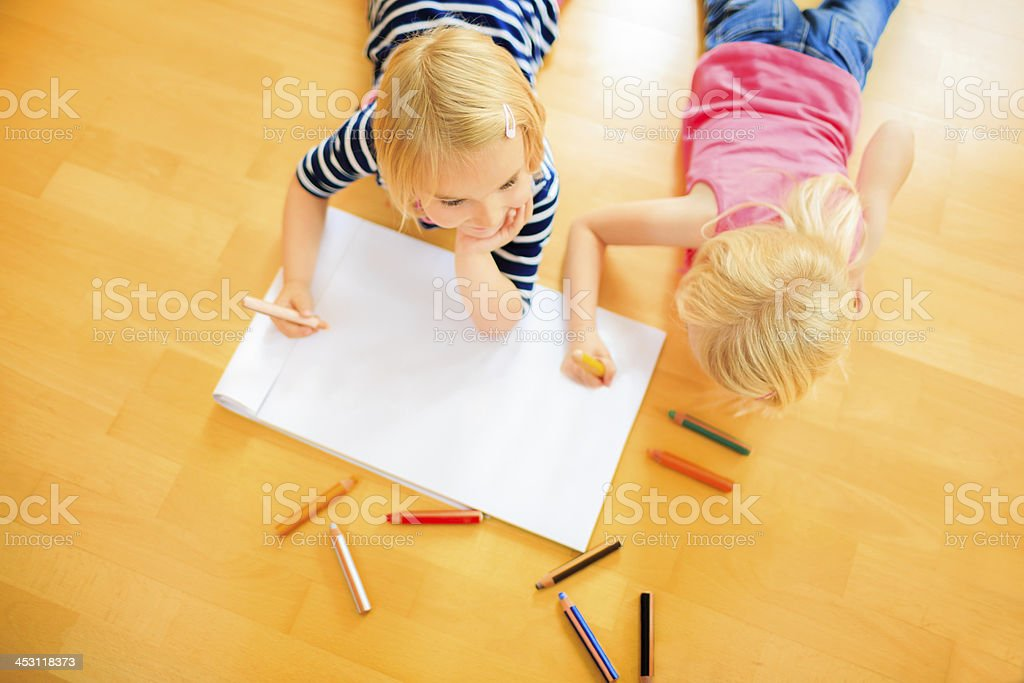High angle view on two girls drawing royalty-free stock photo