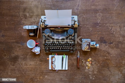 High angle wide view of Travelling tools. Retro typewriter travel items on a old wooden desk, knolling.