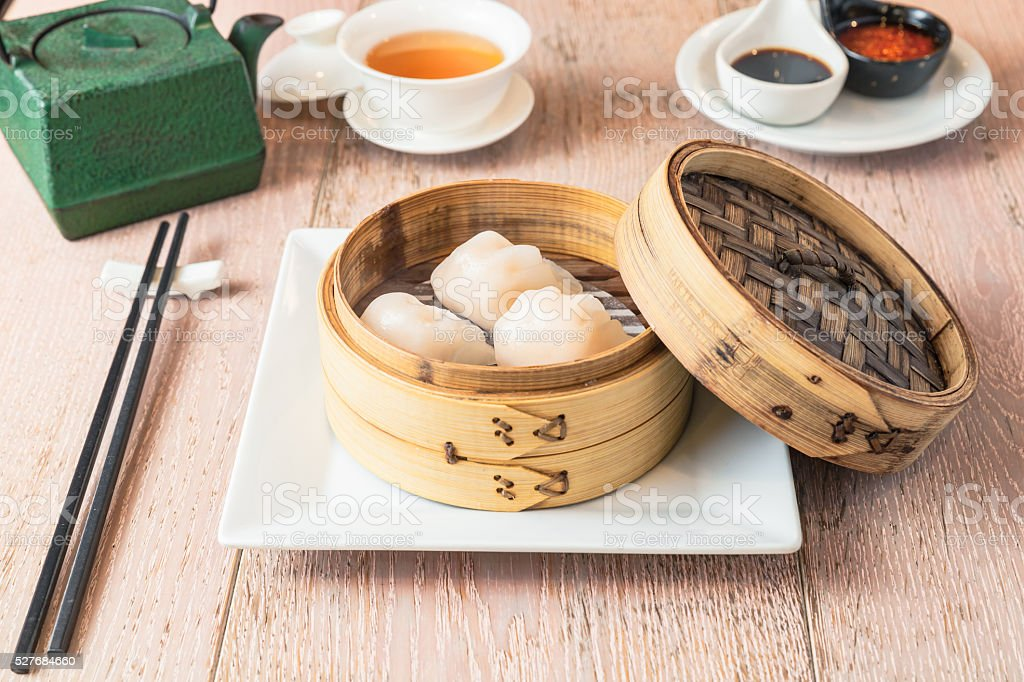 high angled view of a steaming basket with dim sum stock photo