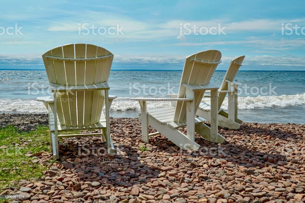 High Back Chairs on Rocky Beach on Lake Superior stock photo