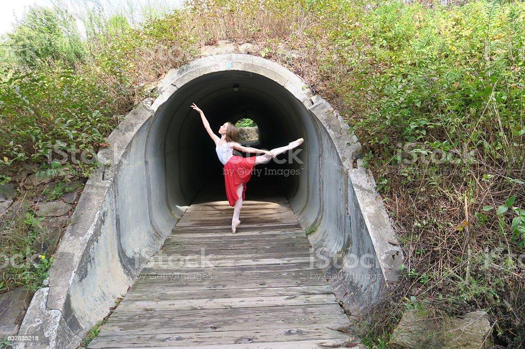 High Ballet Arabesque in Tunnel stock photo
