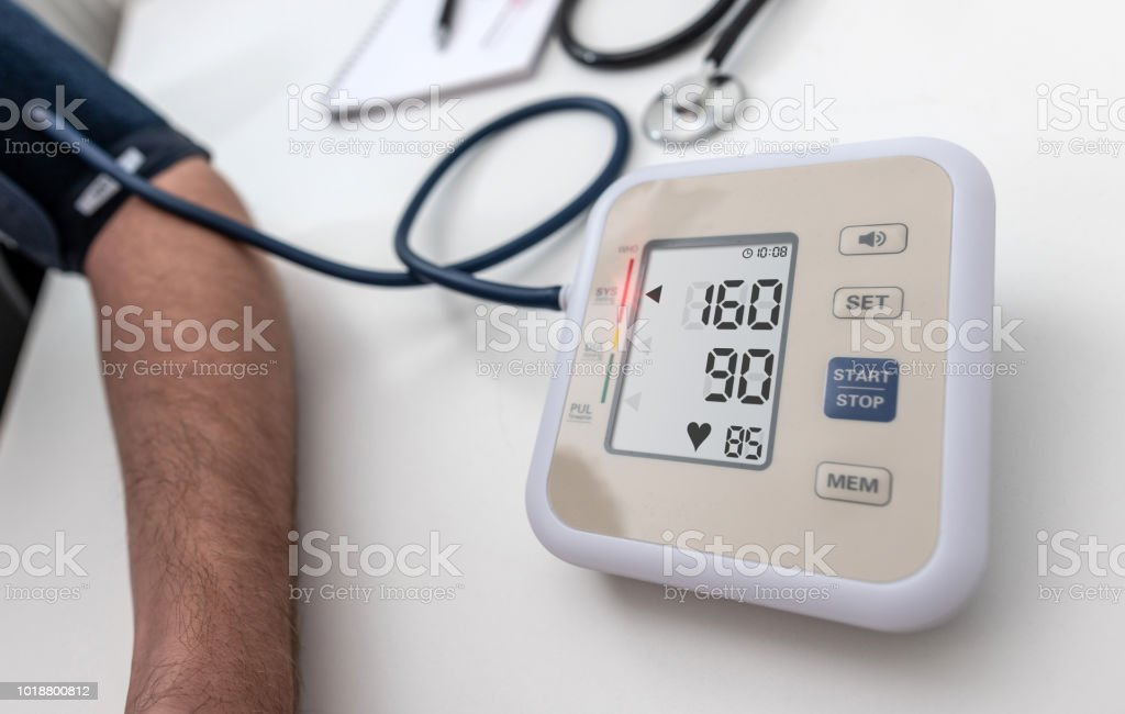 High blood pressure (hypertension) 160/90 on an LCD screen stock photo