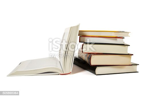 istock High books stack, open book isolated white background. Colorful covers. 505865064