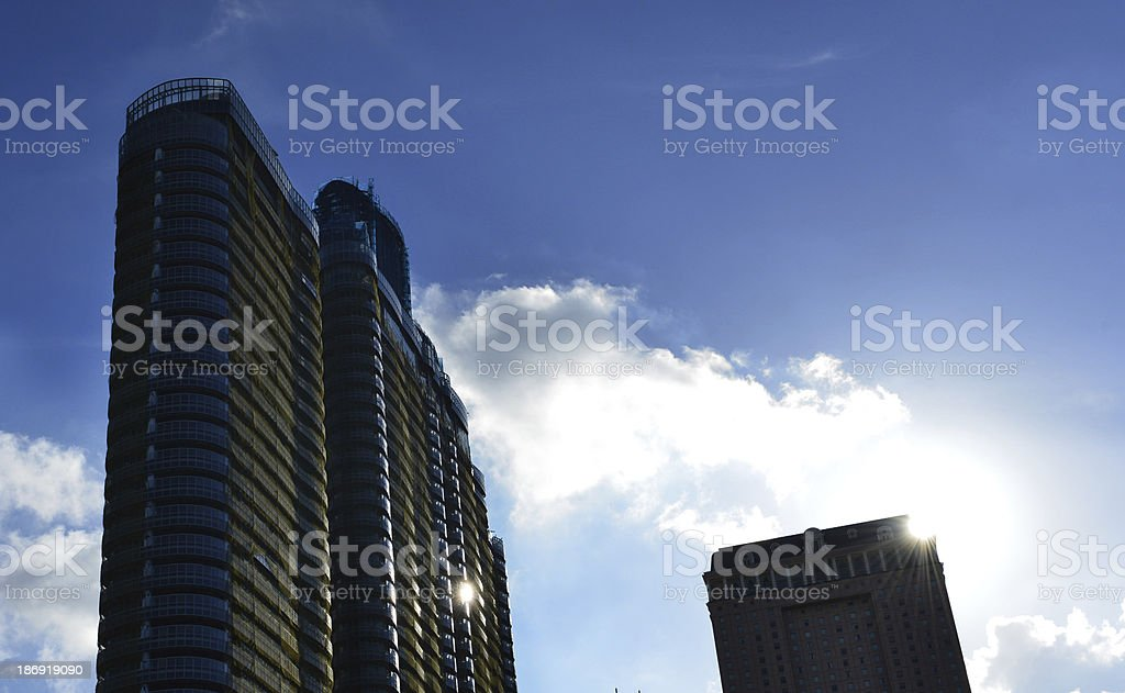 high buildings  in the clouy sky with sunlight beam royalty-free stock photo