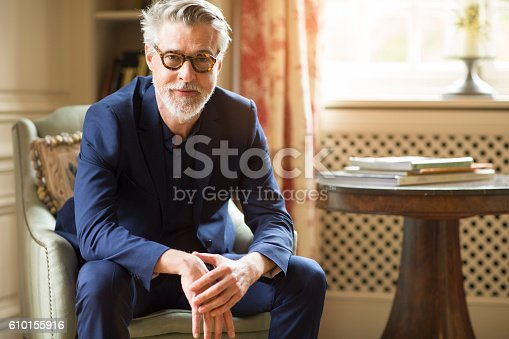 istock High class mature man portrait at home. 610155916