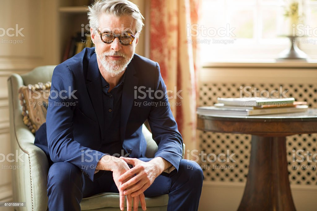 High class mature man portrait at home. stock photo