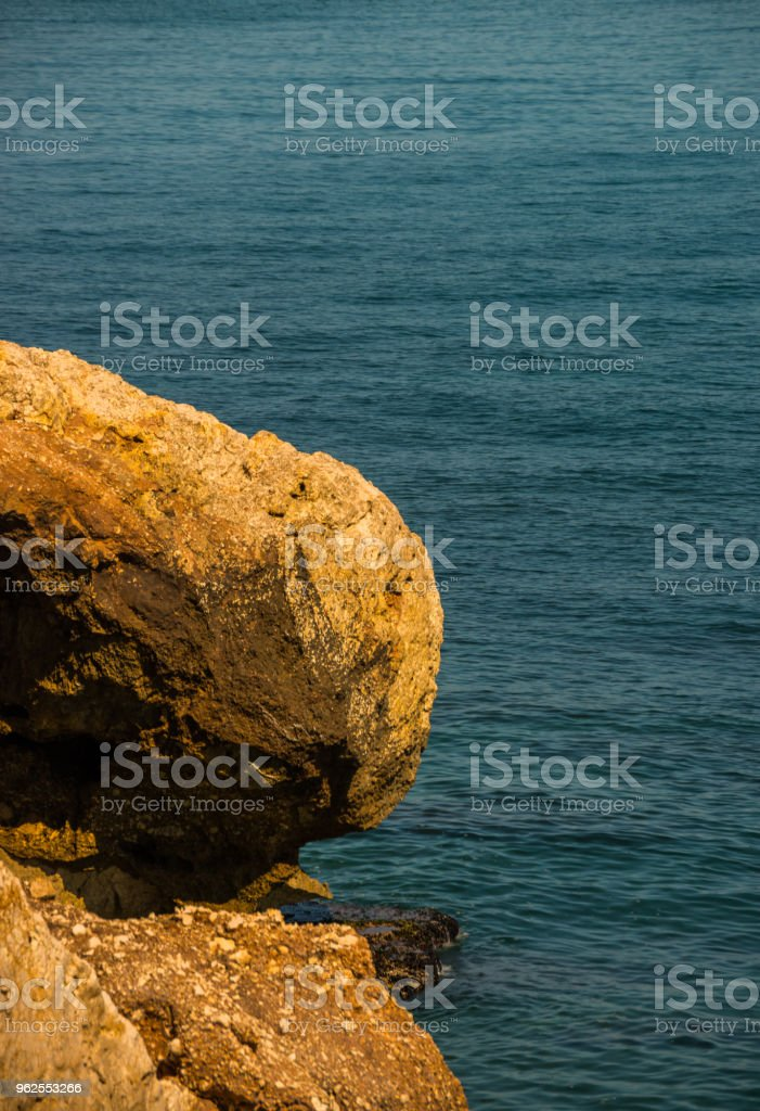 high cliff above the sea, summer sea background, many splashing waves and stone - Royalty-free At The Edge Of Stock Photo