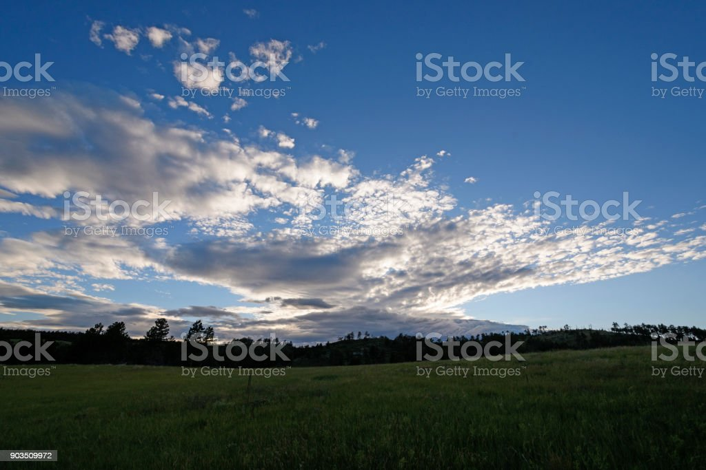 High Clouds over the Black Hills at Twilight stock photo