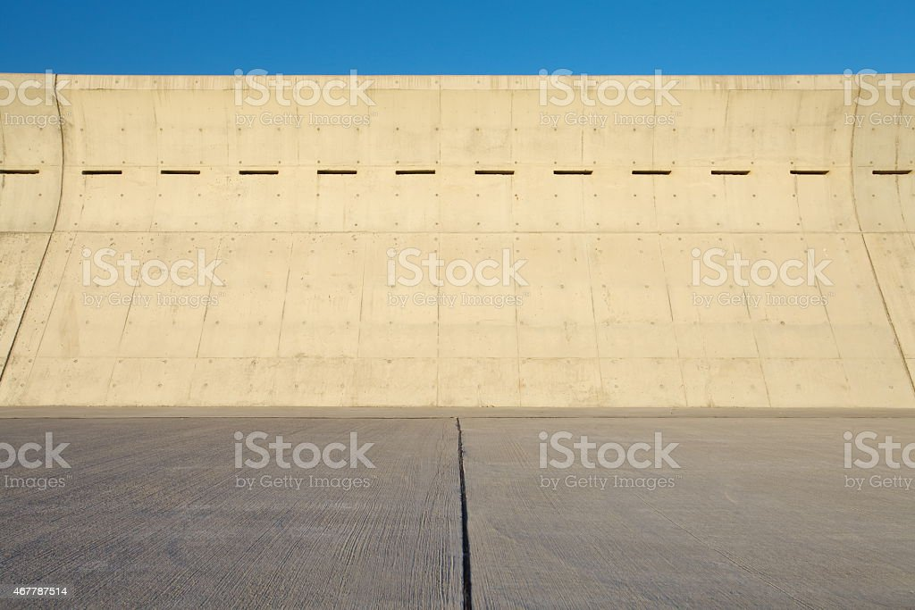 High concrete wall at seaside for protect tsunami big wave stock photo