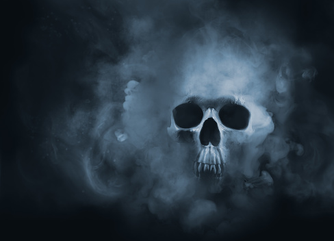 high contrast image of a skull in a smoke cloud