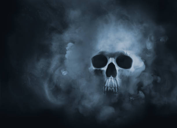 high contrast image of a skull in a smoke cloud Scary skull emerging from a cloud of smoke / high contrast image dead stock pictures, royalty-free photos & images