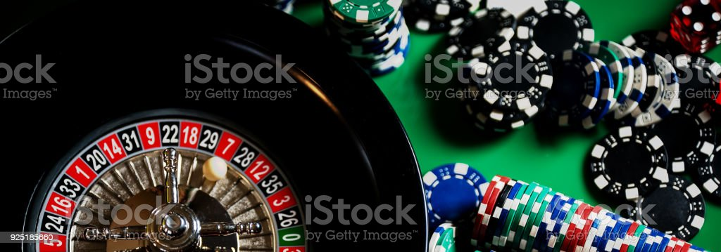 High contrast image of casino roulette and poker chips stock photo