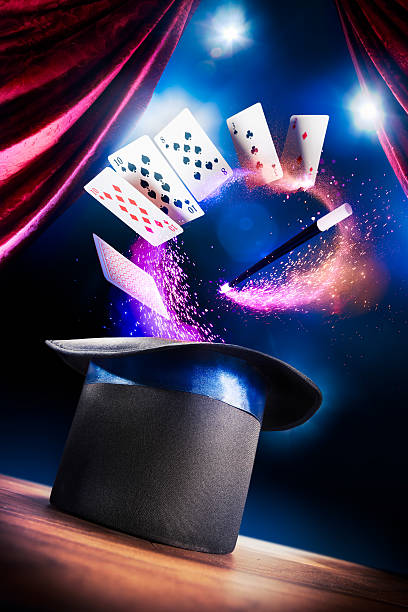 High contrast image of magician hat on a stage photo composite of a magic hat on a stage magic trick stock pictures, royalty-free photos & images