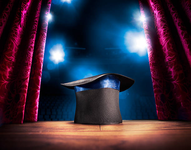 High contrast image of magician hat on a stage photo composite of a magic hat on a stage magician stock pictures, royalty-free photos & images
