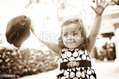 istock High contrast portrait of cheerful small Indian girl 174784822