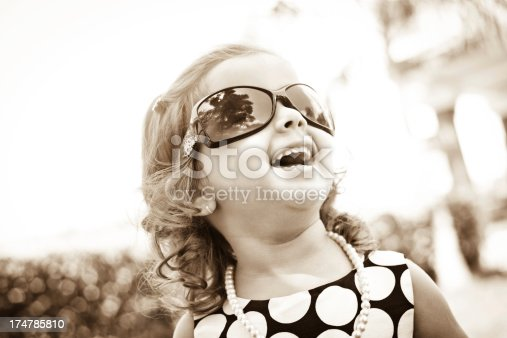 istock High contrast portrait of cheerful small Indian girl 174785810