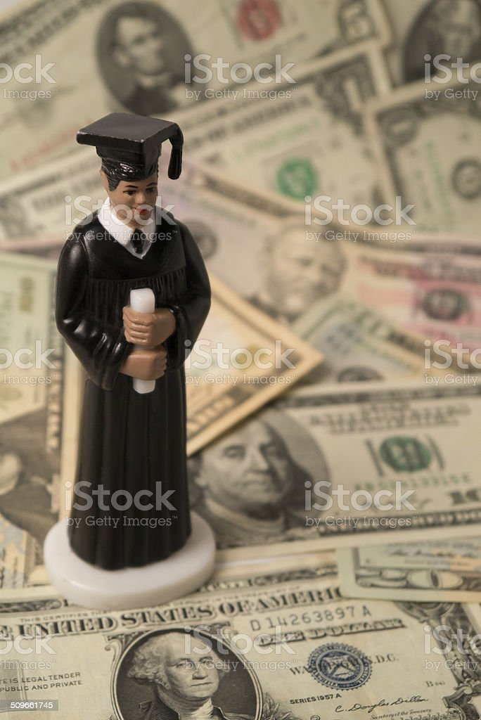 High Cost of Education (Concept) with Male Figurine stock photo