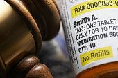 istock High Cost of Prescription Drugs: Concept of legislation prescription bottles with gavel 1127955416