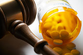 istock High Cost of Prescription Drugs: Concept of legislation prescription bottles with gavel 1127957169