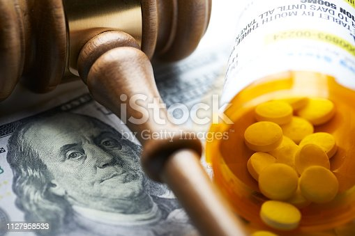 High Cost of Prescription Drugs: Concept prescription bottles with gavel