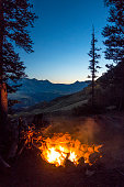Evening camp fire near Last Dollar Pass. San Juan Mountains, Colorado.