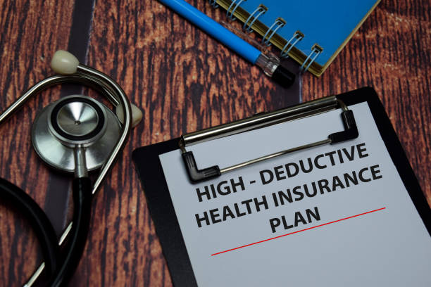 high deductive health insurance plan write on paperwork isolated on wooden table. - deductive stock pictures, royalty-free photos & images