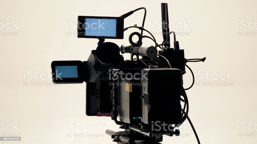 4K high defination video camera with tripod shooting in studio production stock photo