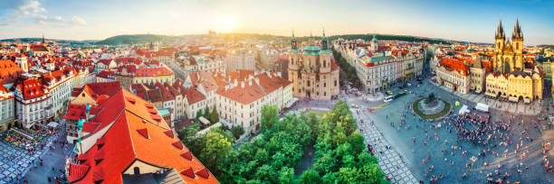 high definition panoramic aerial view from old town square in Prague Panoramic aerial view of Prague at sunset, Czech Republic tyn church stock pictures, royalty-free photos & images