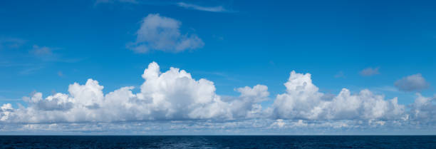 High definition panoramic cloudscape over ocean stock photo