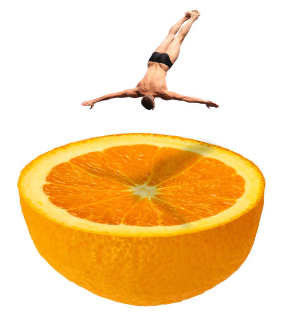 High diving swimmer in swim suit briefs jumping down in a half fresh juicy orange fruit like a swimming pool - manipulated photo concept image - isolated on white High diving swimmer in swim suit briefs jumping down in a half fresh juicy orange fruit like a swimming pool - manipulated photo concept image - isolated on white taking the plunge stock pictures, royalty-free photos & images