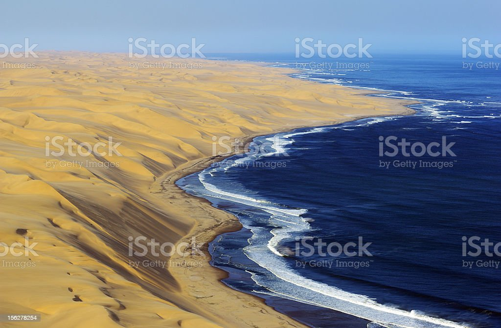 High dunes from Namib Desert and the Atlantic Ocean stock photo