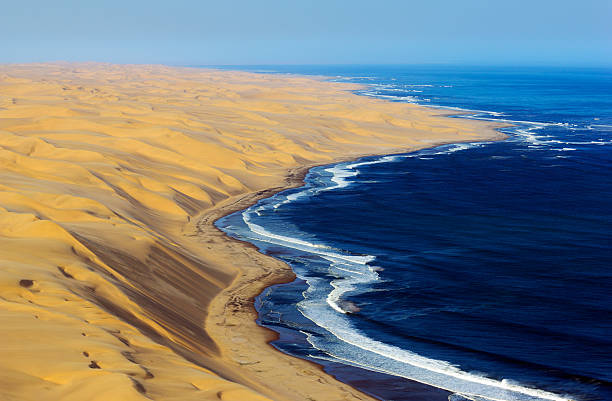 High dunes from Namib Desert and the Atlantic Ocean  namibia stock pictures, royalty-free photos & images