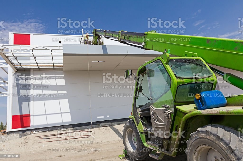 High elevated team of workers on construction site. stock photo