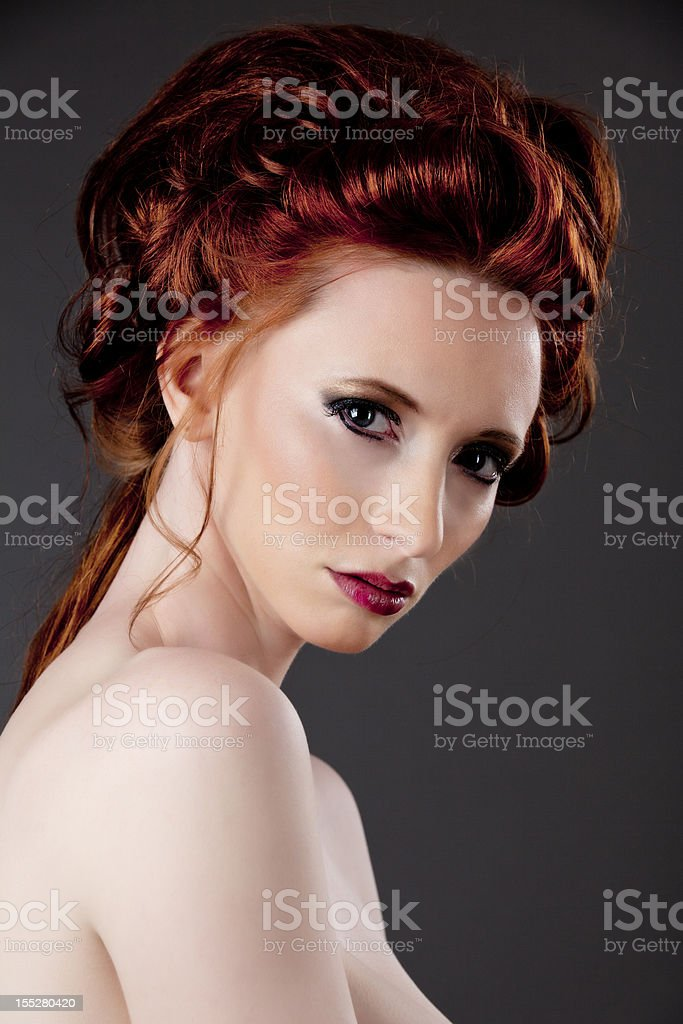 High fashion: elegant model with red hair on grey royalty-free stock photo