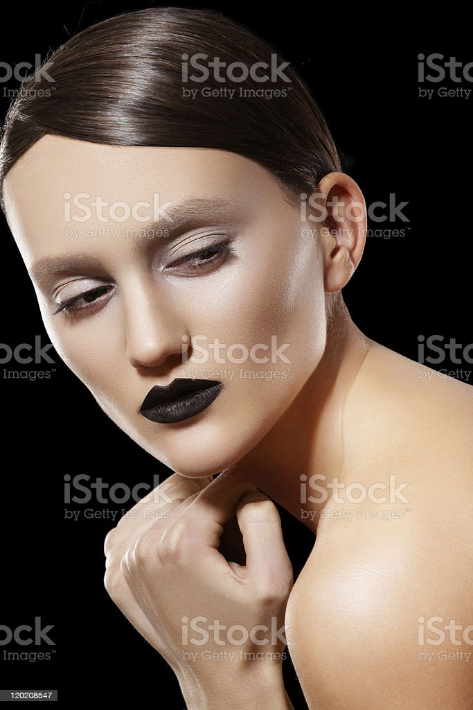 High fashion model with dark lips make-up & shiny hairstyle stock photo