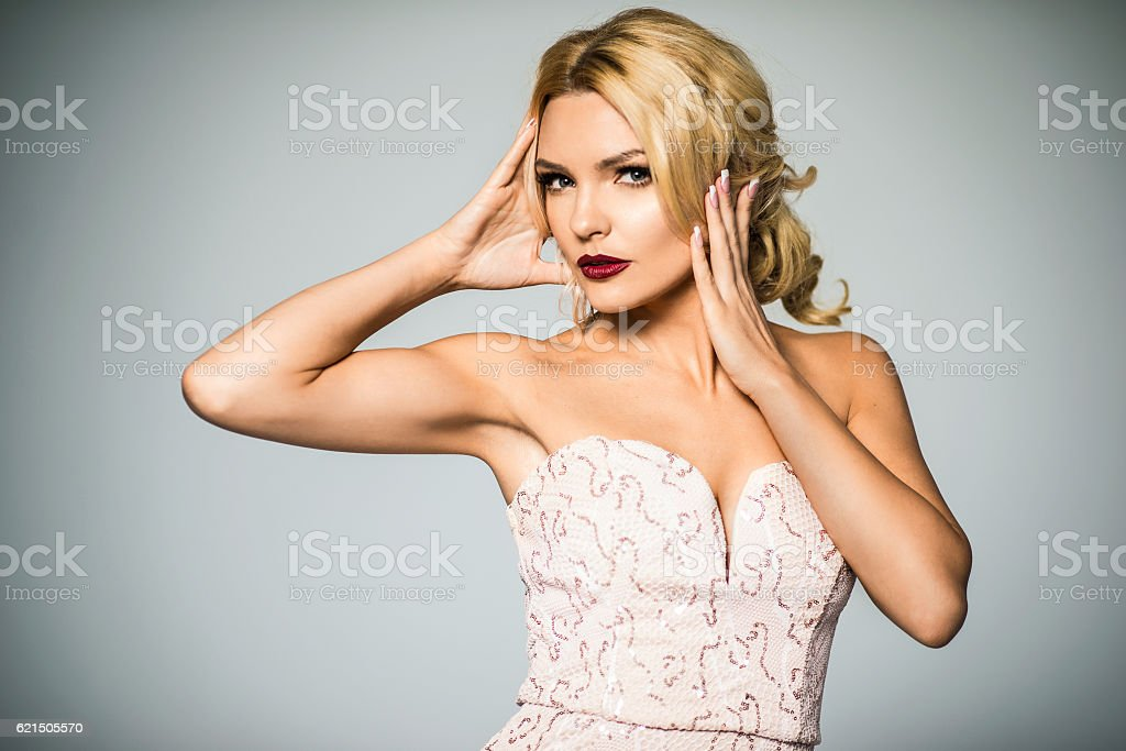 High fashion. shapely blonde in silk evening gown. Femininity Lizenzfreies stock-foto