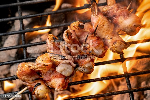 High Fat, Ketogenic Bacon Wrapped Jumbo Shrimp on a fiery old-fashioned Charcoal Grill