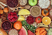 High fibre health food concept with super foods high in antioxidants, omega 3, vitamins &  protein with low GI levels for diabetics. Helps to lower blood pressure & cholesterol & optimise a healthy heart. Flat lay.