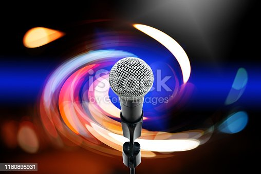 istock High fidelity microphone with light trail. 1180898931