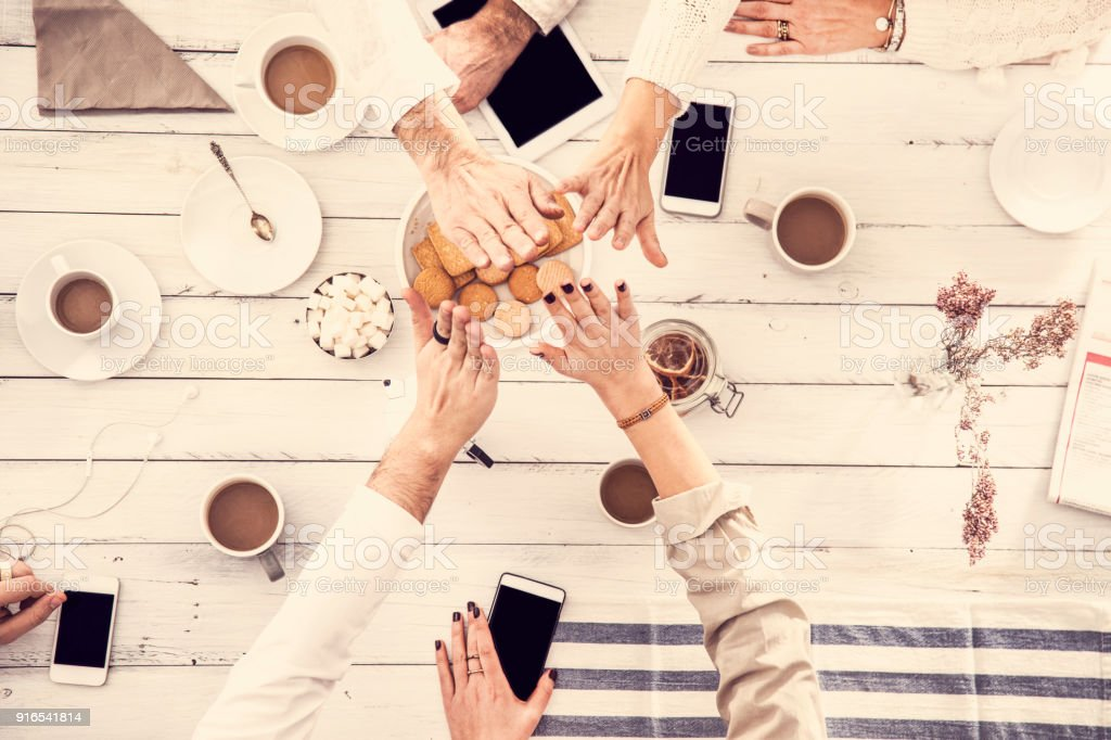 High five hands, people having good time on white wooden table