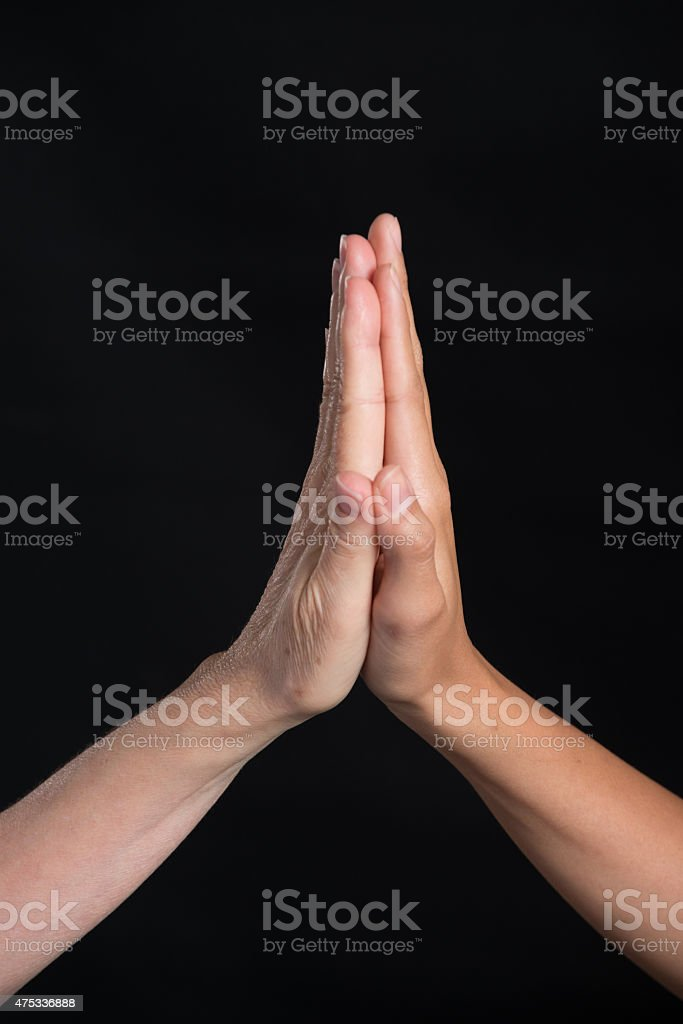 High Five Isolated over Black Background stock photo